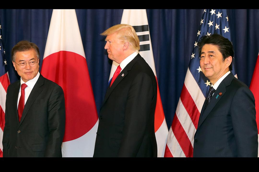 g20峰会开幕前夕,韩国总统文在寅同美国总统特朗普,日本首相安倍晋三图片