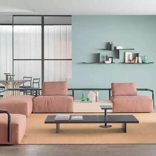 现在流行的北欧极简风格,多采用素色的布艺沙发.图片