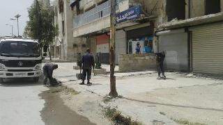 叙利亚最大城市阿勒颇拆危楼修公路,路边竖